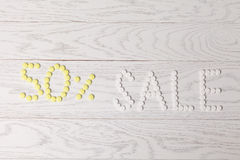 Word Sale made of pills on table Royalty Free Stock Photography