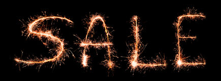 Word SALE made of sparklers Stock Photos