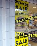 The word sale in shopping window during winter sale time. The word sale oin colorful display in shopping window during winter sale time Royalty Free Stock Photography