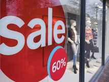 The word sale in shopping window during winter sale time. The word sale oin colorful display in shopping window during winter sale time Royalty Free Stock Image
