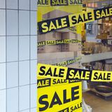 The word sale in shopping window during winter sale time. The word sale oin colorful display in shopping window during winter sale time Stock Photos