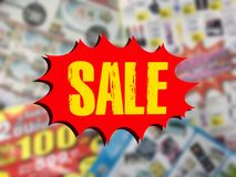 Word SALE on red speech bubble over blurred catalogue background Stock Photos