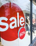 The word sale in shopping window during winter sale time. The word sale oin colorful display in shopping window during winter sale time Stock Image