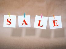 Word sale on slips of paper Royalty Free Stock Photography
