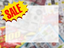 Word SALE on yellow speech bubble with copy space over blurred c. Word SALE on yellow speech bubble with copy space for text over blurred catalogue background Stock Photos