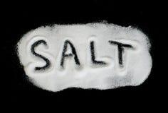 Word Salt on black background Stock Images