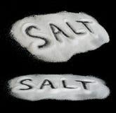 Word Salt on black background Stock Image