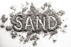 Word sand written in grey industry sand pile Stock Image