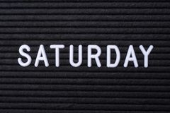 The word SATURDAY. Spelt on a letter board royalty free stock photo