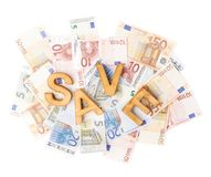 Word Save over the pile of money Stock Photos
