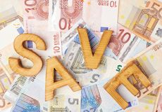 Word Save over the pile of money Royalty Free Stock Photo
