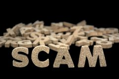 Word scam in cork letters Stock Image