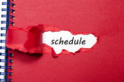 The word schedule appearing behind torn paper. The word schedule behind torn paper Stock Photo