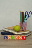 The word school spelled with colorful alphabet blocks displayed Stock Photos