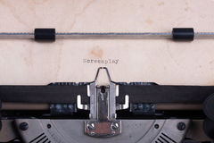 Word Screenplay typed by typewriter. Word Screenplay typed by vintage typewriter Stock Photography