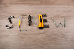 Word made of different repair tools lay on wooden table Stock Image