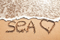Word sea on sand Royalty Free Stock Images