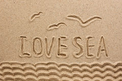 The word  sea  written on the sand Stock Images