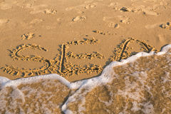 Word sea on the yellow sandy beach Stock Photo