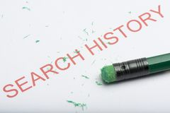Word `Search History` with Worn Pencil Eraser and Shavings. The word `search history` on paper with worn pencil eraser and eraser shavings. Concept of removing Stock Photo