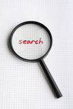 Word SEARCH under magnifying glass Royalty Free Stock Photos