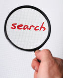 Word SEARCH under magnifying glass Royalty Free Stock Photography