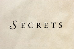 "The Word Secrets. ""Secrets"" word printed on textured paper Stock Image"