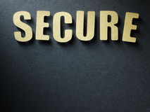 The word Secure on paper background Stock Images