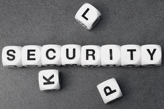 Word security on toy cubes. Word on white toy cubes Stock Photos