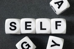 Word self on toy cubes. Word self on white toy cubes Royalty Free Stock Images
