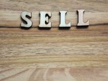 The word sell. Wooden word, `sell` inscription on a wooden background Stock Images