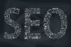 Word seo in Doodle icons. Sketchy chalkboard Royalty Free Stock Image