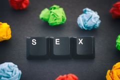 The word Sex on a black background with some colorful crumpled paper balls around it. Sex. The word Sex on a black background with some colorful crumpled paper royalty free stock images