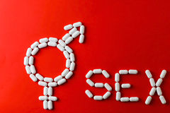 The word sex with capsules and pills with treatments for erectile dysfunction. Royalty Free Stock Photos