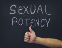 Word Sexual Potency and thumb up hand below. Concept image Stock Image