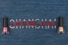 Word Shanghai, made of rhinestones, encrusted on denim. World Fashion. Royalty Free Stock Photography