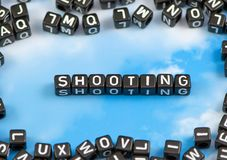 The word shooting. On the sky background Stock Image