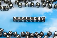The word shoulder. On the sky background stock photos