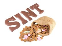 Word SINT and bag of ginger nuts and sweets for Dutch event Sinterklaas Royalty Free Stock Images