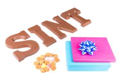 Word SINT, ginger nuts and and wrapped presents for Dutch event Sinterklaas Stock Photos