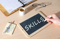 Word skills on a chalkboard. Word skills written on a chalkboard stock photo