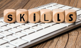 The word skills in wooden block dice Stock Images