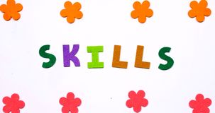 The word skills is written in dancing letters of the colored alphabet.