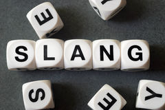 Word slang on toy cubes Royalty Free Stock Photography