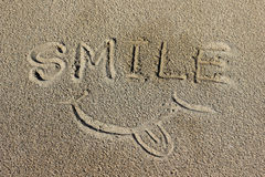 Word Smile on the sand Stock Image