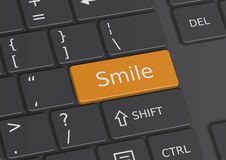 The word Smile written on the keyboard. The word Smile written on a yellow key from the keyboard Royalty Free Stock Image