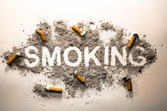 Word smoking made in cigarette ash and bud royalty free stock photography