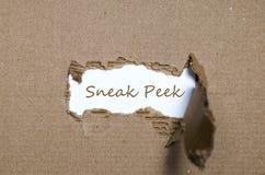 The word sneak peek appearing behind torn paper. The word sneak peek behind torn paper Stock Photos