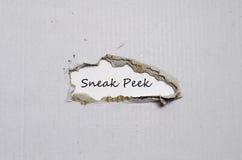 The word sneak peek appearing behind torn paper. The word sneak peek behind torn paper Royalty Free Stock Photos
