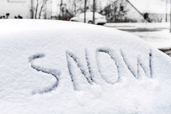 Word snow on a car windshield. Stock Photo